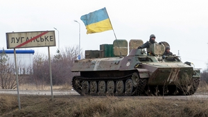 A tank carrying the Ukrainian flag is seen near the town of Lugansk