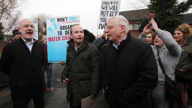 Socialist Cllr Mick Murphy (L), with Paul Murphy and Joe Higgins outside Terenure garda station