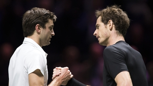 Gilles Simon shakes hands with Andy Murray after beating the Scot in Rotterdam
