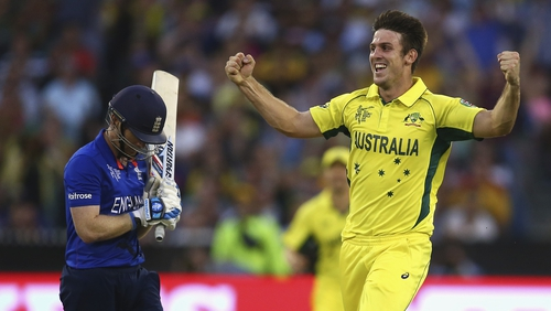 Mitch Marsh of Australia celebrates after taking the wicket of Eoin Morgan
