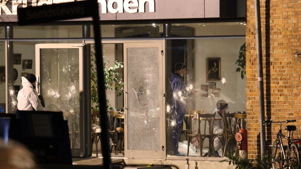 Forensic experts look for clues at the scene of the Copenhagen shooting