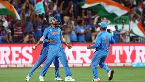 Virat Kohli of India celebrates after taking a catch to dismiss Pakistan's Shahid Afridi