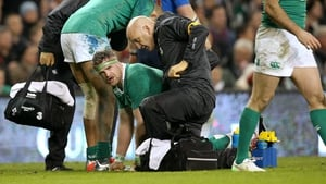 Ireland's Jamie Heaslip receives treatment following the incident with Pascal Papé of France