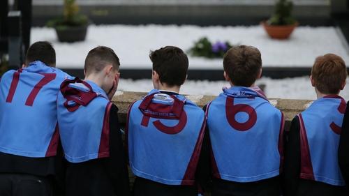 Classmates wearing GAA jerseys at the funeral of Oisin McGrath