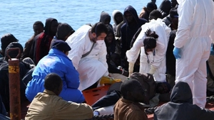 Some of the migrants receive help after arriving in Sicily