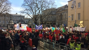 Around 1,000 people involved in the childcare sector have assembled outside Leinster House