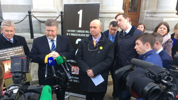 James Reilly (second from left) says Ireland has always been a leader in tobacco control measures