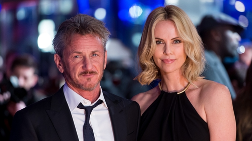 Penn and partner Charlize Theron at the premiere