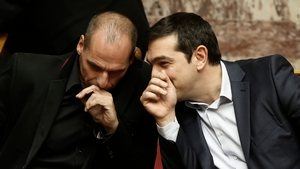 Greek Prime Minister Alexis Tsipras (R) and Finance Minister Yanis Varoufakis in the Athens parliament