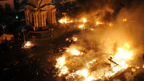 A day and night of bloody clashes saw flames engulf Maidan square, which resembled a war zone