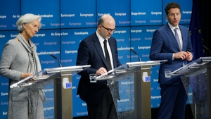 Christine Lagarde, Pierre Moscovici, and Jeroen Dijsselbloem give a press briefing on the deal