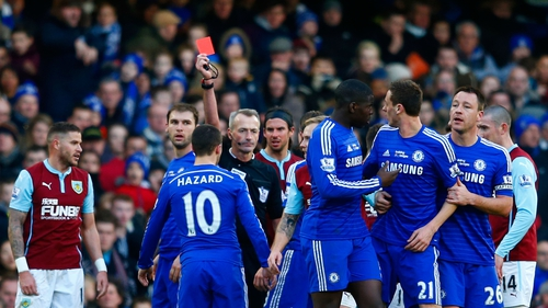 Referee Martin Atkinson shows a red card to Nemanja Matic for his reaction to a tackle by Burnley's Ashley Barnes