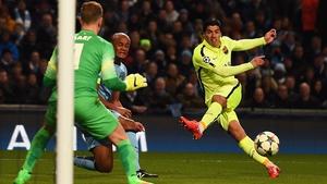 Luis Suarez guides Barcelona's opening goal past Joe Hart
