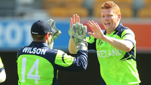 Kevin O'Brien celebrates a wicket with wicket keeper Gary Wilson during today's nail-biting win over UAE
