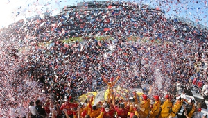 Joey Logano of Shell Pennzoil Ford celebrates in victory lane after winning the NASCAR Sprint Cup Series 57th Annual Daytona 500 at Daytona International Speedway, Florida