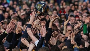 Rival teams the 'Up'ards and Down'ards' battle for the ball during the annual Ashbourne Shrovetide 'no rules' football match in Ashbourne, England