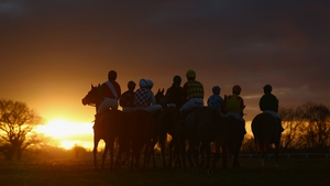 Horses and riders gather for the final race at Taunton Racecourse in England