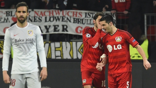 Leverkusen's midfielder Hakan Calhanoglu chats with his team mate Bosnian defender Emir Spahic after scoring