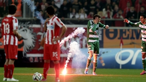 A flare thrown by Olympiakos supporters hits Panathinaikos' Marcus Berg earlier this month