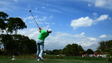 Rory McIlroy plays his shot from the second tee