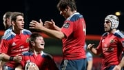 Munster's Jack O'Donoghue celebrates scoring a try with Donncha O'Callaghan