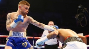 Chris Avalos attempts to evade Carl Frampton at the Odyssey Arena