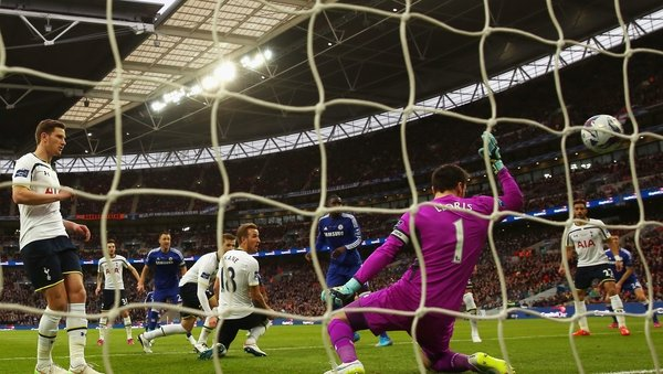 John Terry of Chelsea scores the opening goal past Tottenham goalkeeper Hugo Lloris