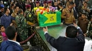 Members of the Iraqi Shia militia accompany the coffins of their comrades killed in clashes with the so-called IS