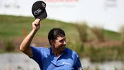 Padraig Harrington tips his hat to the crowd as he walks to the green on the second play-off hole during the continuation of the fourth round of The Honda Classic