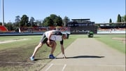 Peter Johnston inspects the pitch at the Manuka Oval