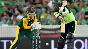 Ireland's Kevin O'Brien (R) in action at the 2015 Cricket World Cup