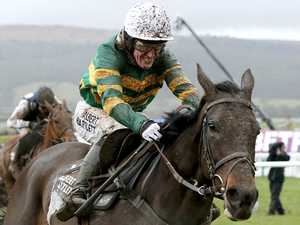 Tony McCoy in typical pose as At Fishers Cross wins the 2013 Albert Bartlett Novices' Hurdle