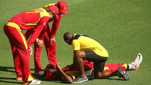 Elton Chigumbura of Zimbabwe grimaces after being injured against Pakistan