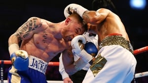 Carl Frampton takes a punch from Chris Avalos but would ultimately come out on top during their IBF Super-Bantamweight World title fight on Saturday night