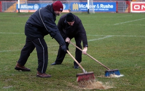 Ground staff removing surface water from the pitch before the Tyrone v Derry game