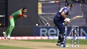 Bangladesh captain Mashrafe Mortaza (L) bowls to Kyle Coetzer, who  became the first Scottish player to score a World Cup century