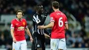 Newcastle's Papiss Cisse (L) confronts Manchester United's Jonny Evans