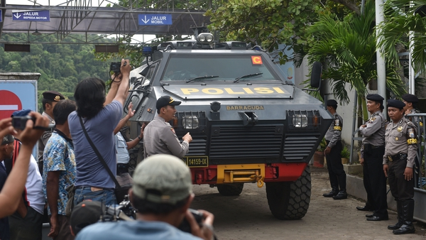 Indonesian police armoured vehicles carrying the Australians leaves the maximum security prison in Nusa Kambangan
