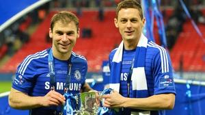 Nemanja Matic (R) with team-mate Branislav Ivanovic and the League Cup