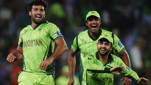 Sohail Khan of Pakistan celebrates with Rahat Ali and Ahmad Shahzad of Pakistan after dismissing South Africa's AB de Villiers