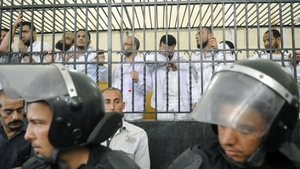 Defendant's react from behind bars during their trial over the violence
