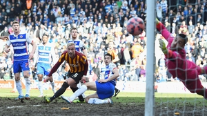 Republic of Ireland internationals Alex Pearce and Stephen Kelly look on as a Bradford chance sails just wide