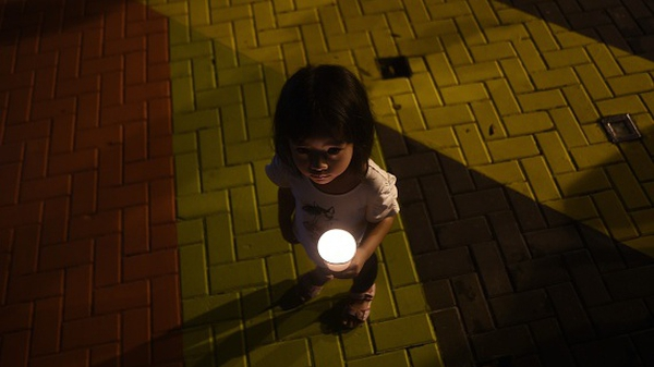 A young girl during a gathering to mark the one-year anniversary of the disappearance of the plane