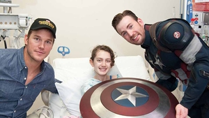 Chris Pratt and Chris Evans with a patient at Seattle Children's Hospital who looks delighted to see them