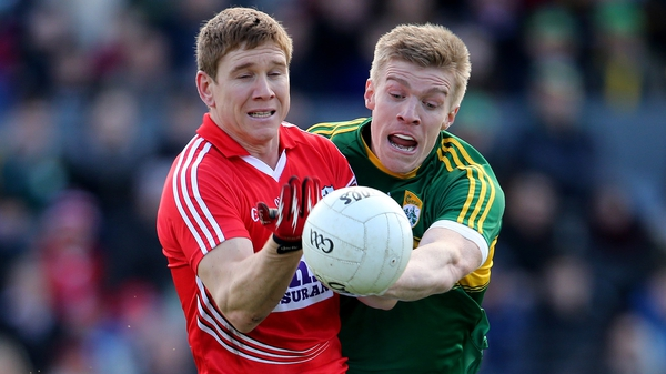 Cork's Stephen O'Donoghue (L) is tackled by Tommy Walsh of Kerry