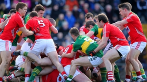 A schmozzle, tending towards a melee, between Cork and Kerry players during the first half