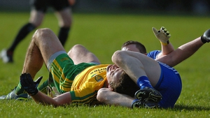 Monaghan's Dermot Malone with Michael Murphy of Donegal