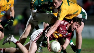 Meath's Bryan Menton and Daragh Daly of Westmeath battle for the ball