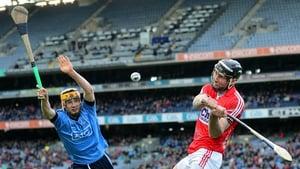 Dublin's Eamonn Dillon attempts to block the clearance of Cork's Mark Ellis