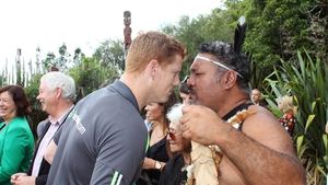 Kevin O'Brien is welcomed by a Maori man during a ceremony in Hamilton